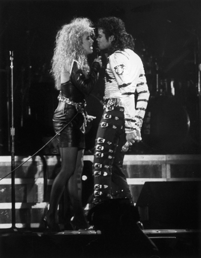 Sheryl Crow performs a duet with Michael Jackson during a concert in Rome,1988.