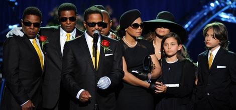 Michael Jackson's siblings, from left, Tito Jackson, Jermaine Jackson, Marlon Jackson, Randy Jackson, Janet Jackson, LaToya Jackson and children Paris and Prince Michael Jackson stand on the stage at the memorial.